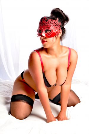 Ava in red lingerie and mask