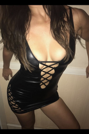 Lilly in leather dress showing off her nice boobs